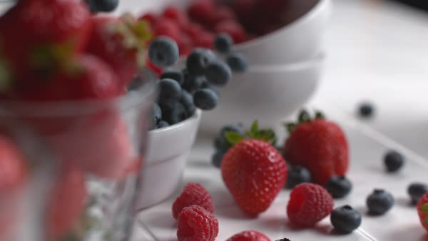 Berries falling into bowl in super slow motion Royalty-free stock video
