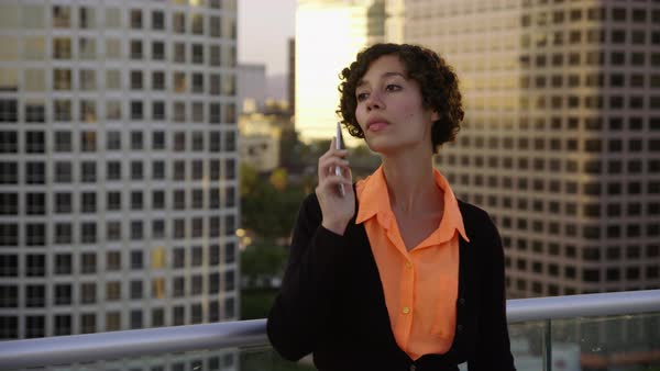 Businesswoman using cell phone on rooftop in city Royalty-free stock video