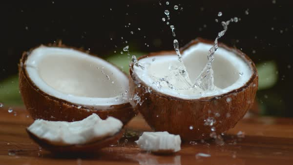 Coconut water splashing in super slow motion Royalty-free stock video