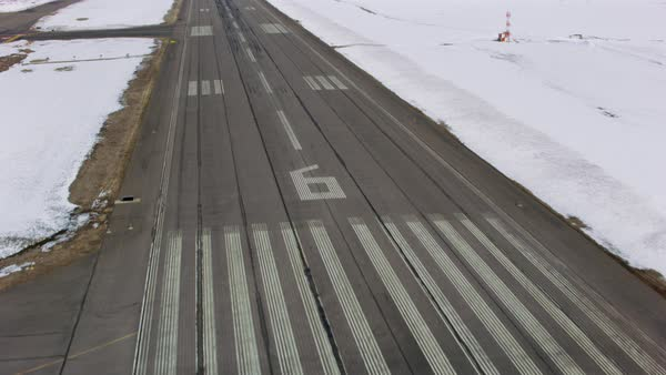 Aerial view of landing on a airport runway in winter, Colorado Royalty-free stock video