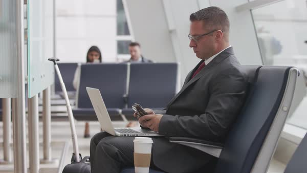 Businessman using laptop at airport Royalty-free stock video
