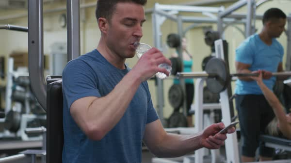 Man at gym drinks water Royalty-free stock video