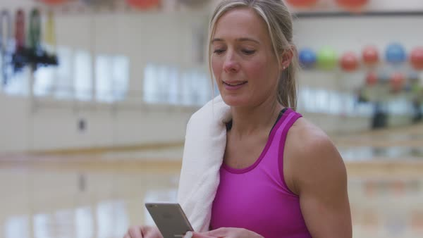 Woman at gym listening to music Royalty-free stock video