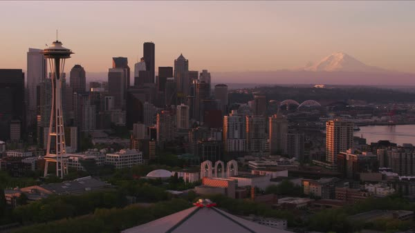 Aerial view of Seattle at sunrise with Space Needle and Mt. Rainier.   Royalty-free stock video