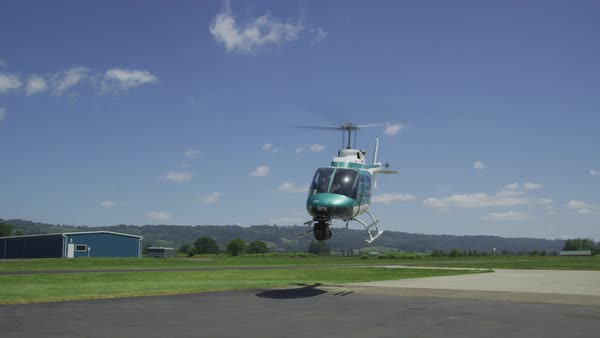 Helicopter taking off at rural airport.  Shot with RED Epic.  Royalty-free stock video