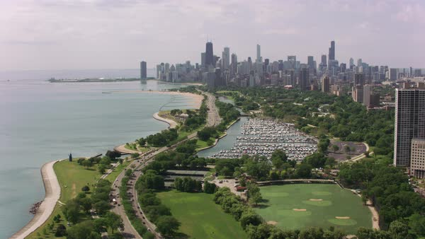 Flying over Lincoln Park towards downtown Chicago.   Royalty-free stock video