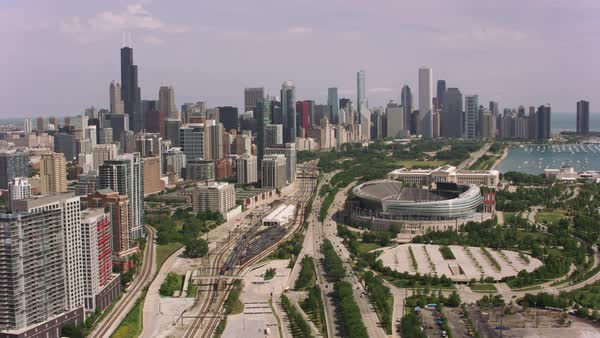 Aerial shot of Soldier Field and downtown Chicago.   Royalty-free stock video
