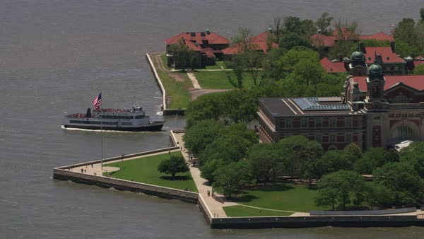 Aerial shot of ferry leaving Ellis Island.   Royalty-free stock video