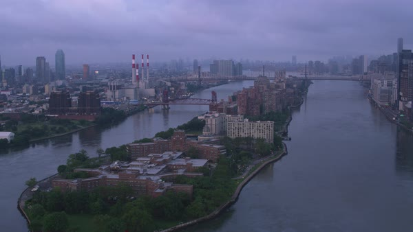 Flying down East River over Roosevelt Island at sunrise.   Royalty-free stock video