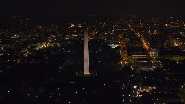Aerial view of the Washington Monument and Capitol Mall area at night.    Royalty-free stock video