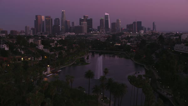 Flying over Echo Park with downtown Los Angeles in distance.   Royalty-free stock video