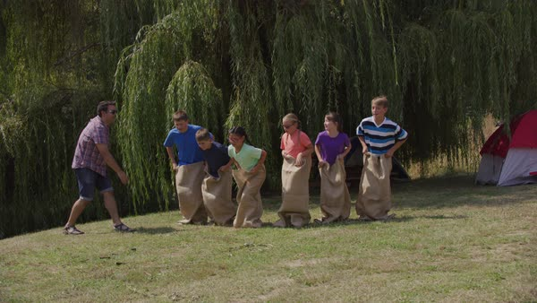 Kids at summer camp in gunny sack race Royalty-free stock video