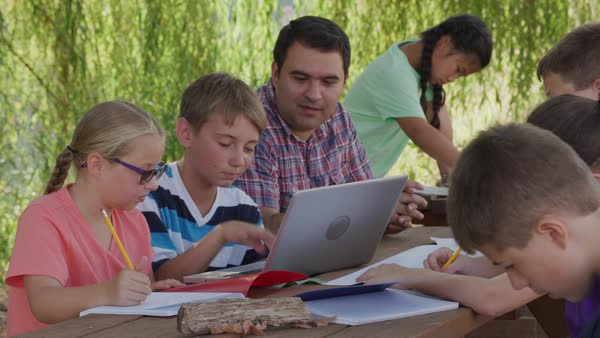 Kids at outdoor school using laptop computer Royalty-free stock video