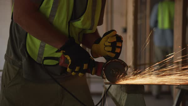 Construction worker grinding metal and making sparks, closeup Royalty-free stock video