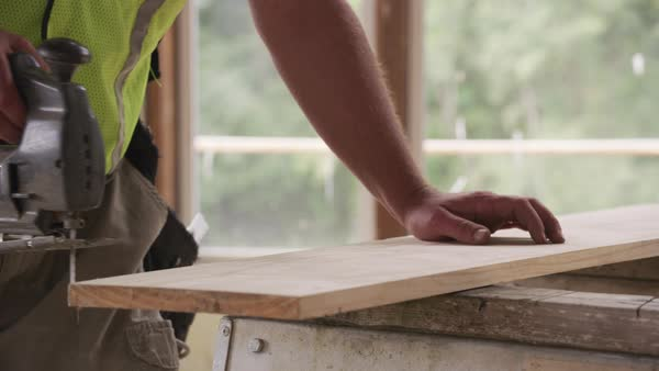 Closeup of construction worker using jigsaw Royalty-free stock video