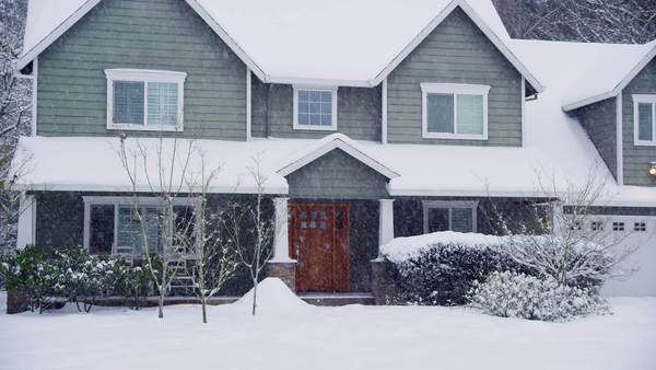 Home exterior in snow storm Royalty-free stock video