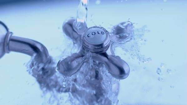 Cold water tap with water splashing in slow motion Royalty-free stock video