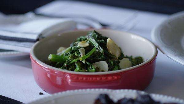 Close-up shot of broccolini with almonds Royalty-free stock video