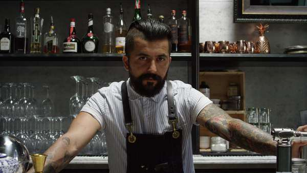 Medium shot of bartender standing behind the counter Royalty-free stock video