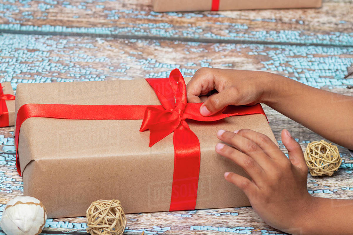 Little girl opening presents on Christmas day Royalty-free stock photo