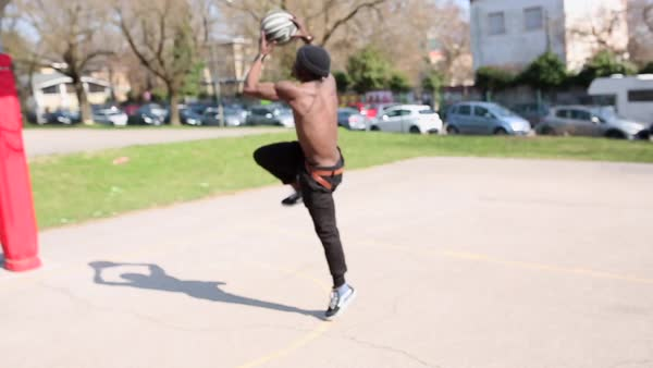 Tracking shot of a man playing basketball on an empty court Royalty-free stock video