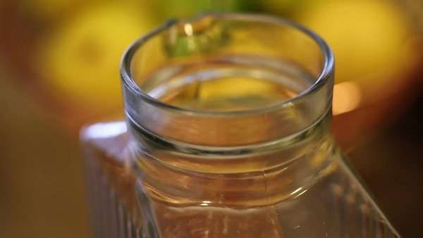 Hand-held close up shot of simple syrup being poured into jug. Royalty-free stock video