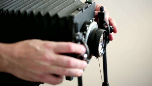 Photographer adjust the focus on a vintage camera Royalty-free stock video