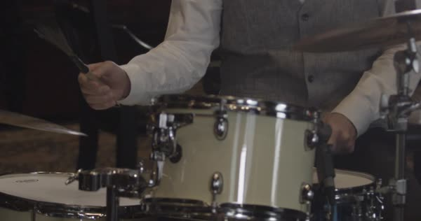 Handheld close-up shot of a man playing the drum Royalty-free stock video
