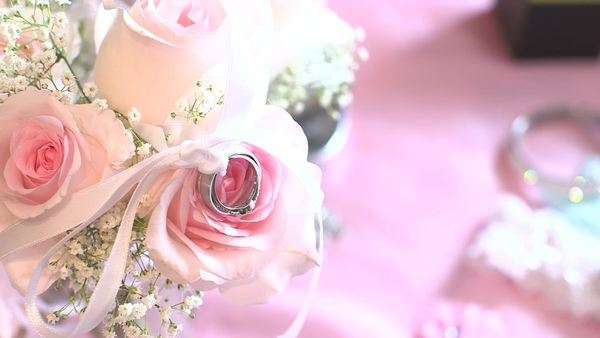 Handheld shot of a ring on a flower bouquet Royalty-free stock video