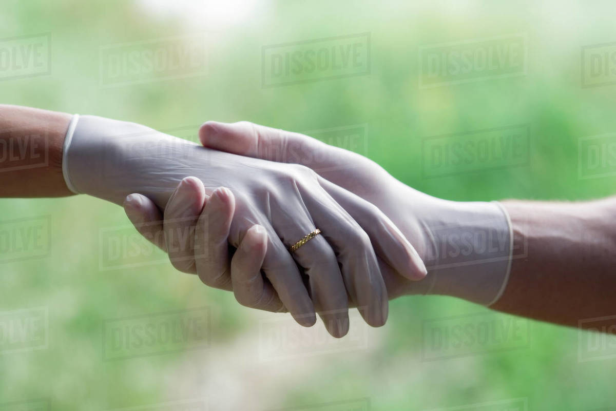 Romantic handshake wearing white rubber, gloves and ring Royalty-free stock photo