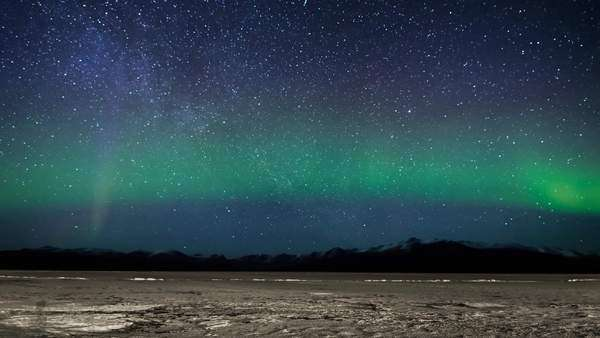 Timelapse of Aurora from Destruction Bay over Kluane lake in Kluane National Park, Yukon Royalty-free stock video