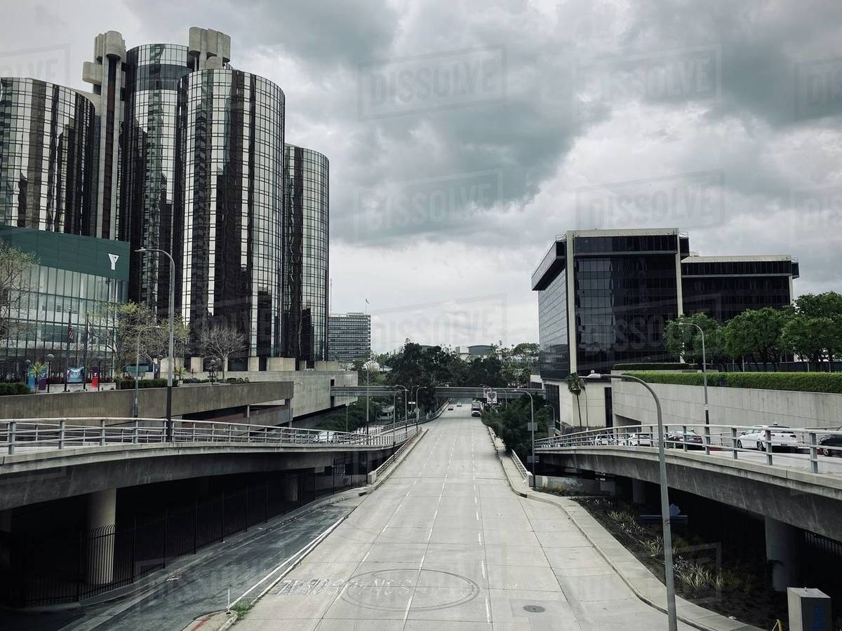 """LOS ANGELES, CA, MAR 2020: looking west on empty 4th Street during coronavirus """"stay at home"""" orders. Downtown YMCA and Westin Bonaventure hotel on left. Royalty-free stock photo"""