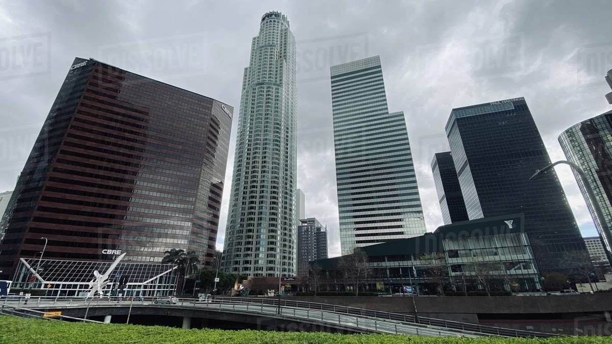 LOS ANGELES, CA, MAR 2020: Downtown YMCA framed by skyscrapers on overcast day in Downtown Financial District Royalty-free stock photo