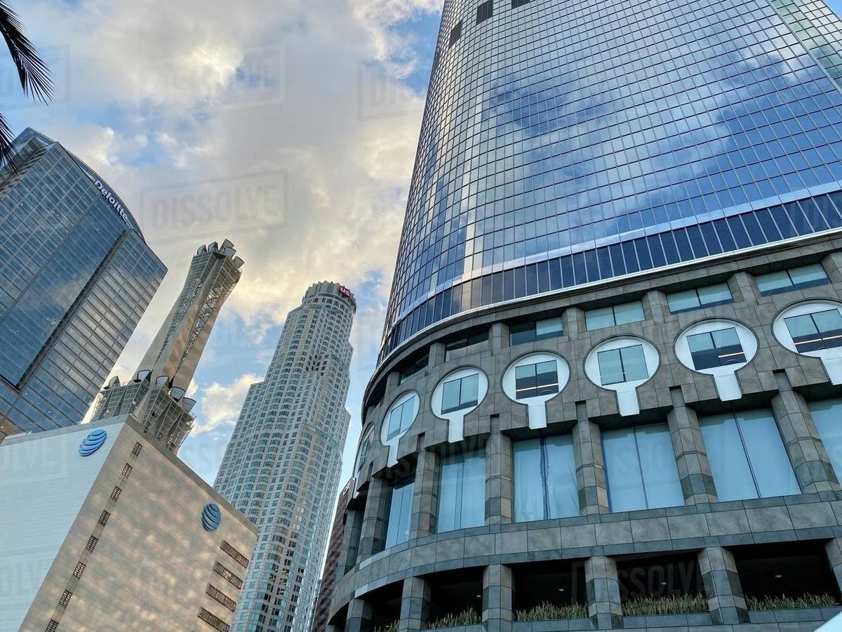 LOS ANGELES, CA, MAR 2020: US Bank Tower and nearby tall buildings viewed past bottom of skyscraper at California Plaza in Downtown on cloudy day Royalty-free stock photo