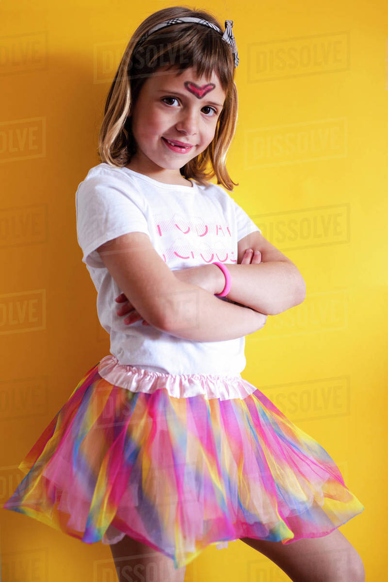 girl dressed as a dancer on a yellow background during quarantine Royalty-free stock photo