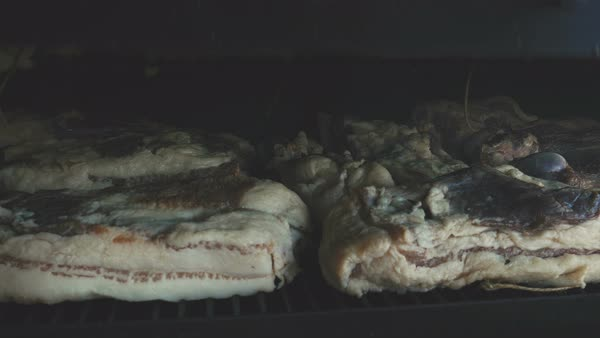 Dry smoking pig bacon in a smoker  Royalty-free stock video