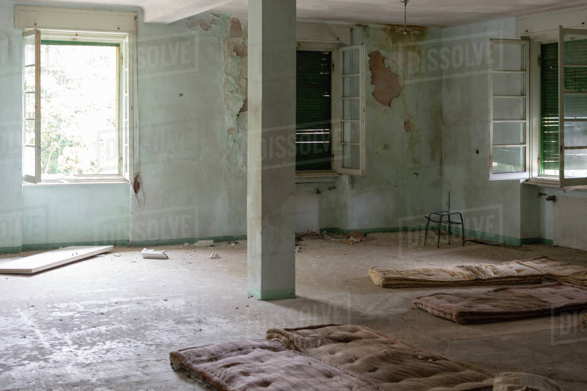 Old bed in abandoned kid colony room in Italy Royalty-free stock photo