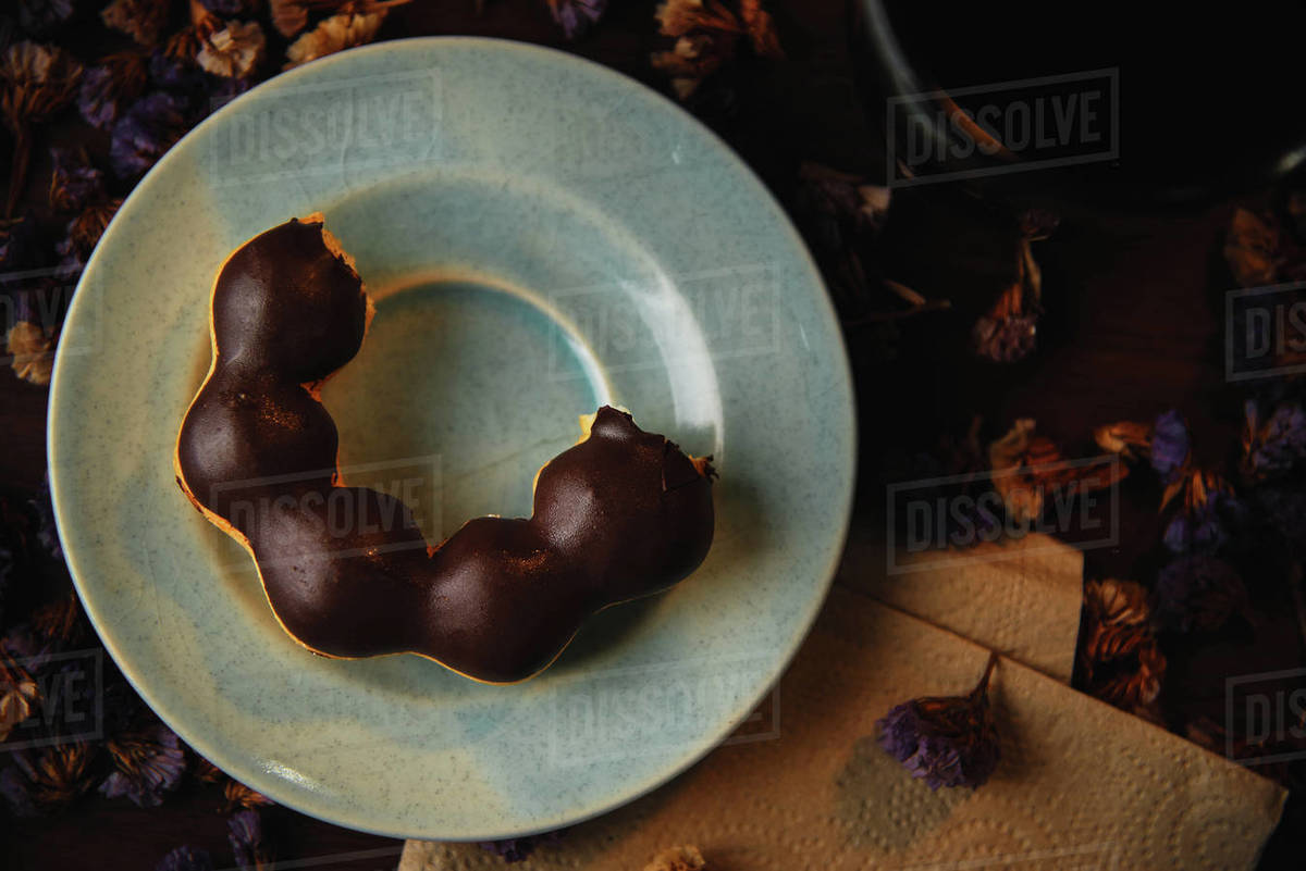 A chocolate donut served on blue plate Royalty-free stock photo