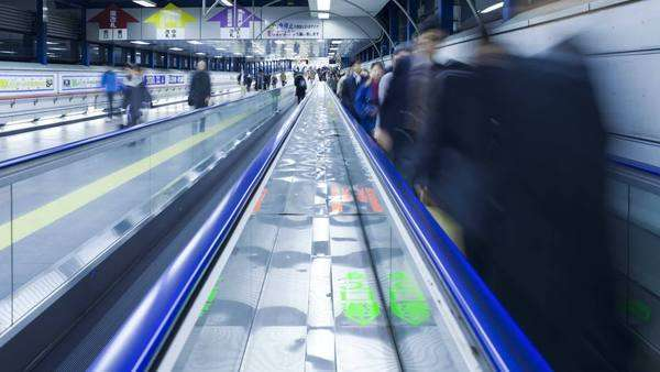 Timelapse Commuters on a moving walkway in  Shibuya Station at rush hour, Shibuya, Tokyo, Honshu, Japan Royalty-free stock video