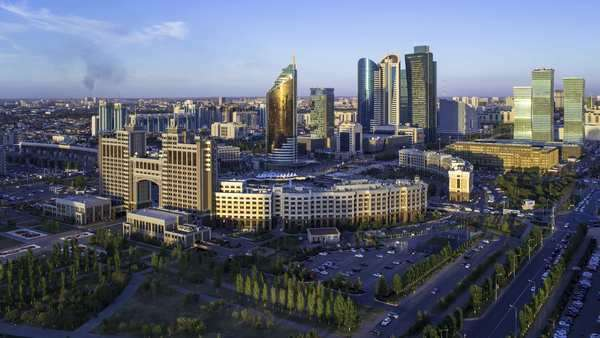 Central Asia, Kazakhstan, Astana, elevated view over the city center and central business district- Day to night timelapse transistion Royalty-free stock video