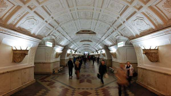 Belorusskaya Metro station beneath ceiling panels depicting Belarussian life, Moscow, Russia - timelapse Royalty-free stock video