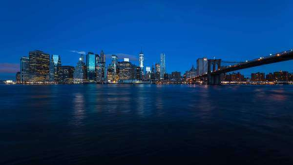 USA, New York City, Downtown Financial district of Manhattan, One World Trade Center and the Brooklyn Bridge - timelapse Royalty-free stock video