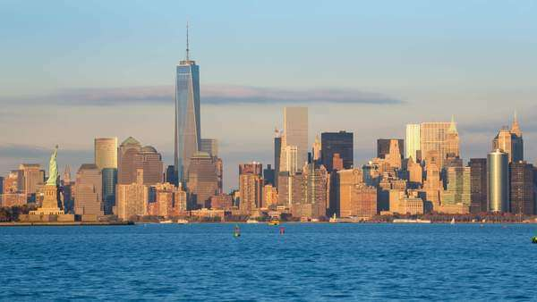 Statue of Liberty, One World Trade Center and Downtown Manhattan across the Hudson River, New York, Manhattan, United States of America - timelapse Royalty-free stock video