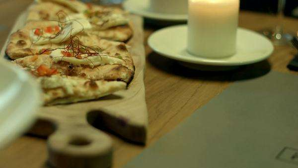 Pizza slices served on a restaurant table. Royalty-free stock video