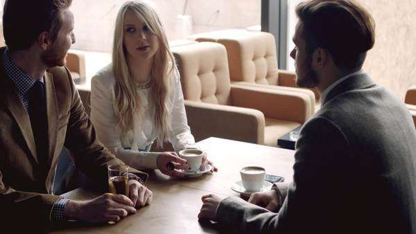 Group of people drinking coffee and chatting at a café. Royalty-free stock video