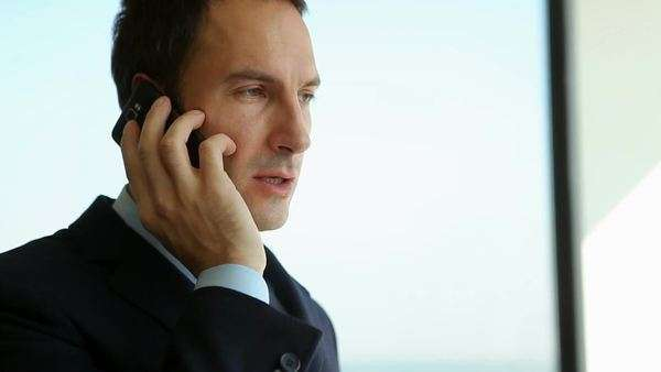 Smiling businessman telephoning at his office. Royalty-free stock video