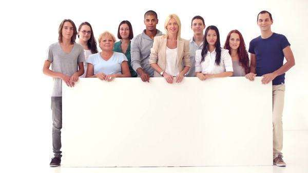Group of people standing behind a big blank panel and smiling. Royalty-free stock video