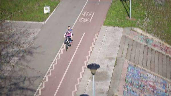 Overhead view of a woman riding a bicycle. Royalty-free stock video
