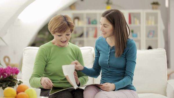 Mother and daughter reading a magazine together. Royalty-free stock video