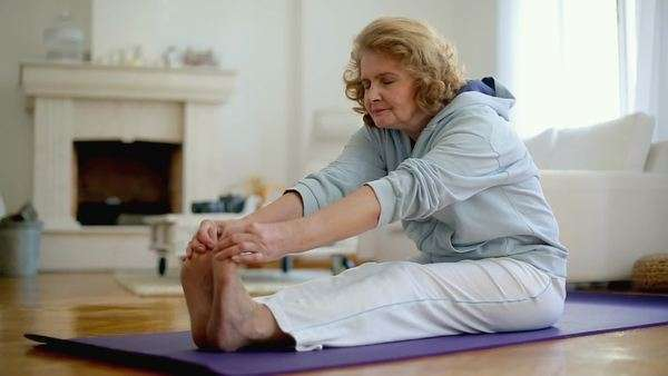 Senior Caucasian woman doing yoga at home. Royalty-free stock video